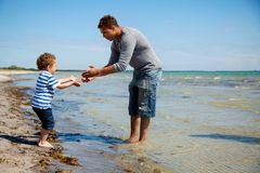 Boy Takes Little Steps Towards His Father royalty free stock photo