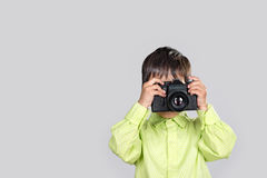 The boy takes the photo with camera Stock Photo