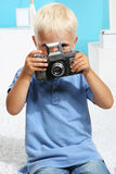 Boy takes a picture Royalty Free Stock Image