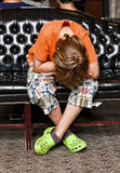 Boy takes a rest at a sofa Stock Photos