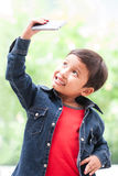 Boy takes selfie with mobile phone. Little boy takes selfie with mobile phone Stock Image