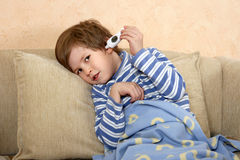 The boy takes temperature by electronic thermometer Stock Photography