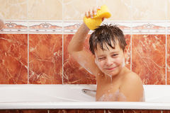 Boy taking bath Stock Photography