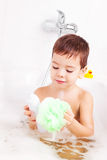 Boy taking a bath Royalty Free Stock Image