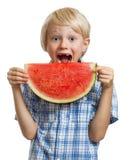 Boy taking bite of water melon Royalty Free Stock Photo