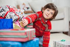 Boy Taking Christmas Gift From Stack Stock Photos