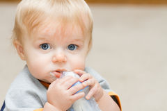 Boy taking a drink Royalty Free Stock Photos