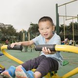 Boy taking exercise. Chinese boy taking exercise on playground Royalty Free Stock Photography
