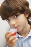 Boy Taking Medicine Stock Photo