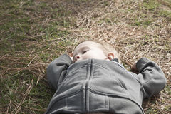 Boy Taking Nap On Grass Stock Images
