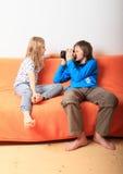 Boy taking photo of girl Stock Photo