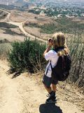 Boy taking a photo on a hiking trail stock images