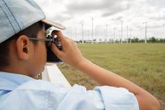 Boy taking photo of wind turbine Royalty Free Stock Image