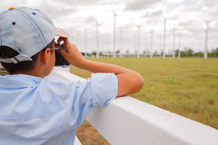 Boy taking photo of wind turbine Royalty Free Stock Photo