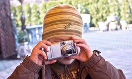 Boy taking photograph Stock Photos
