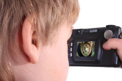 Boy taking a photograph. Isolated photo of young boy taking a photograph with compact digital camera Royalty Free Stock Photography
