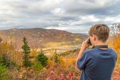 Boy taking photos Stock Photography