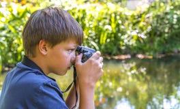 Boy taking photos outdoor Stock Photography