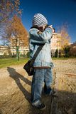 Boy taking picture. Image of a boy taking pictures outside Royalty Free Stock Photo