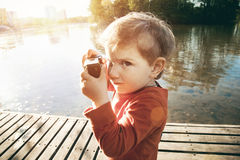 Boy taking picture with camera Royalty Free Stock Photography