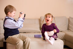 Boy taking picture of his sister Royalty Free Stock Photography