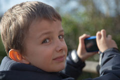 Boy taking picture Stock Photography