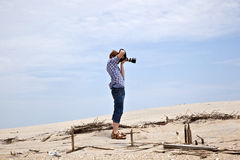 Boy taking pictures at the  beach Royalty Free Stock Photos