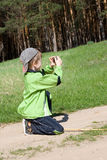 Boy taking pictures and playing with a camera Stock Photo