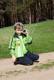 Boy taking pictures and playing with a camera Royalty Free Stock Image