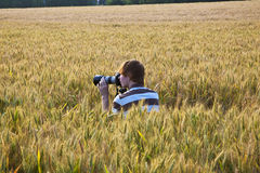 Boy taking pictures with tripod Royalty Free Stock Photography