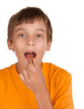 Boy taking a pill Stock Photography