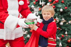 Boy Taking Present From Santa Claus Royalty Free Stock Image
