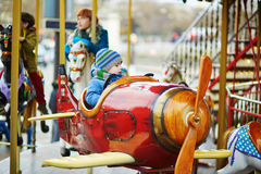 Boy taking a ride in plane on merry-go-round Royalty Free Stock Photography