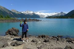 Boy Taking self Shots at Garibaldi Lake Stock Photos
