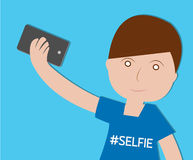 Boy Taking Selfie on blue background Royalty Free Stock Images