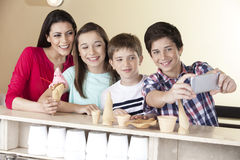 Boy Taking Selfie With Family At Ice Cream Parlor Royalty Free Stock Photo