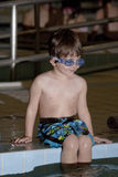 Boy taking a swim lesson Royalty Free Stock Image