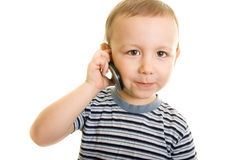 Boy talk over the phone. Boy holding the phone in his hand Stock Photography