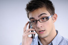 Boy talking. White, young, handsome man talking on mobile Royalty Free Stock Images