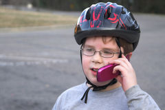 Boy Talking on a Cell Phone royalty free stock images