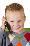 Boy talking on a cell phone - isolated Stock Images