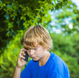 Boy talking on a cell phone. Stock Photo