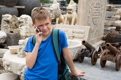 Boy talking on mobile Panjiayuan Antique Market, Beijing Stock Image