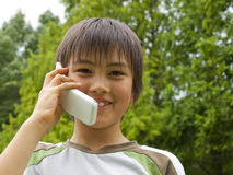 Boy talking with mobile phone stock images