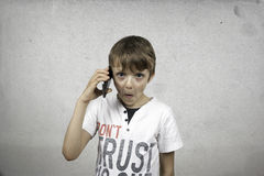 Boy talking on mobile phone Royalty Free Stock Photography