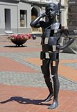 Boy talking on the mobile phone - modern art sculpture Royalty Free Stock Images