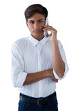 Boy talking on mobilephone. Against white background Royalty Free Stock Image