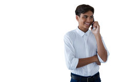 Boy talking on mobilephone. Against white background Stock Photography