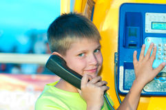 Boy is talking on the  phone Stock Image