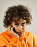 A boy is talking on the phone Stock Images